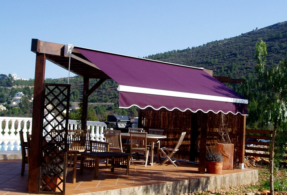 Pergola with integral Concertina Awning